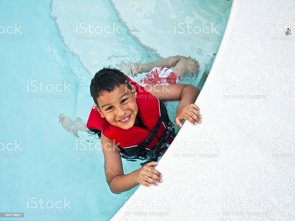 cute boy swimming stock photo
