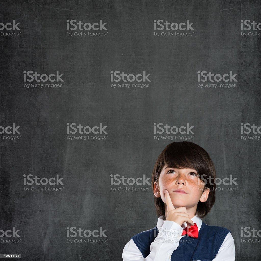 Cute boy thinking stock photo
