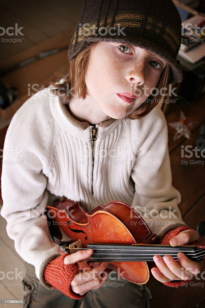Cute Boy with Attitude Playing His Fiddle or Violin stock photo