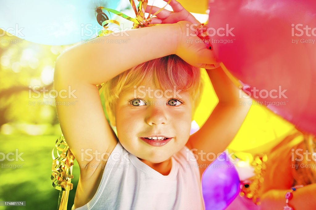 Cute boy with balloons stock photo