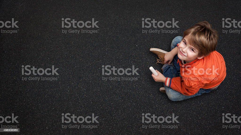 Cute Boy, with Chalk on Street/Tarmac stock photo