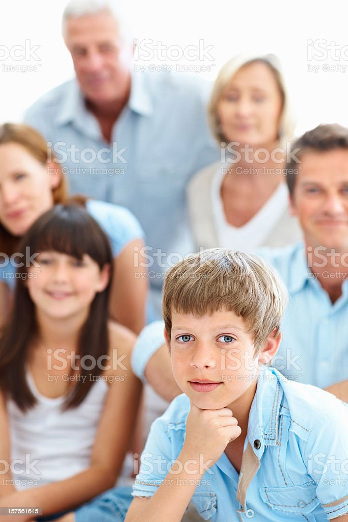 Cute boy with family in the background royalty-free stock photo