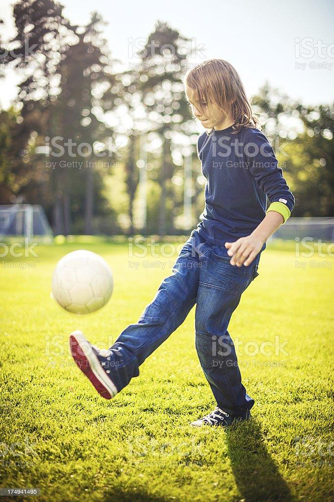 Cute boy with football stock photo
