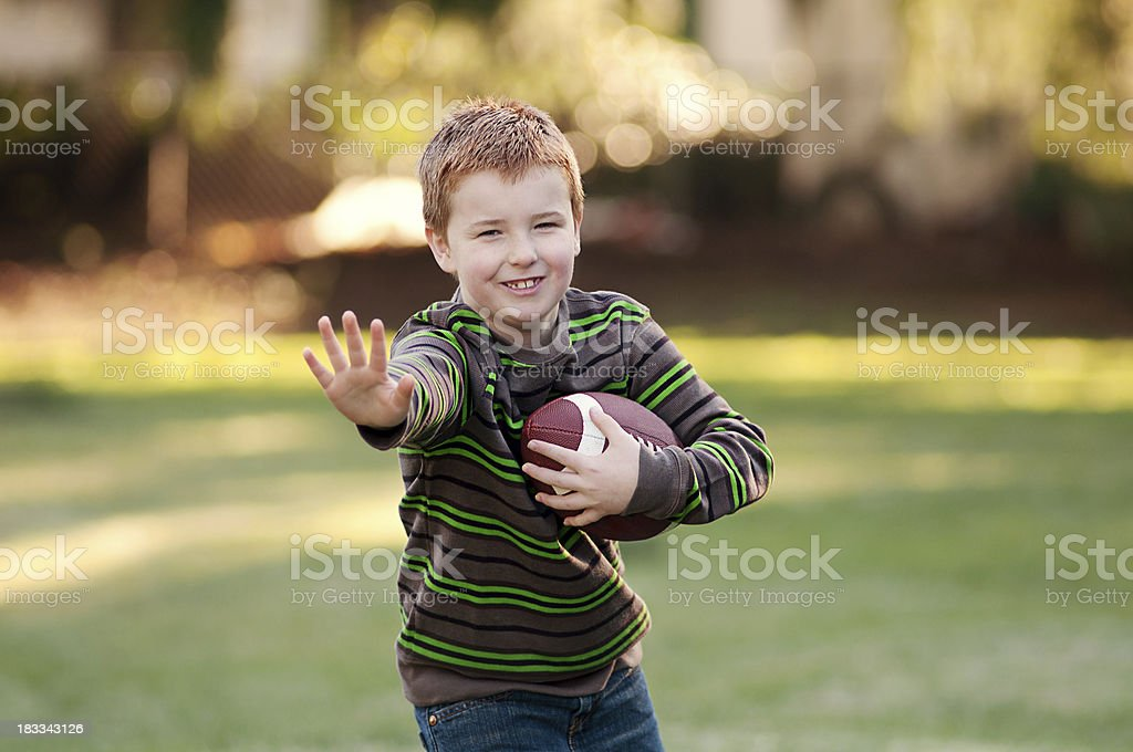 Cute boy with football royalty-free stock photo