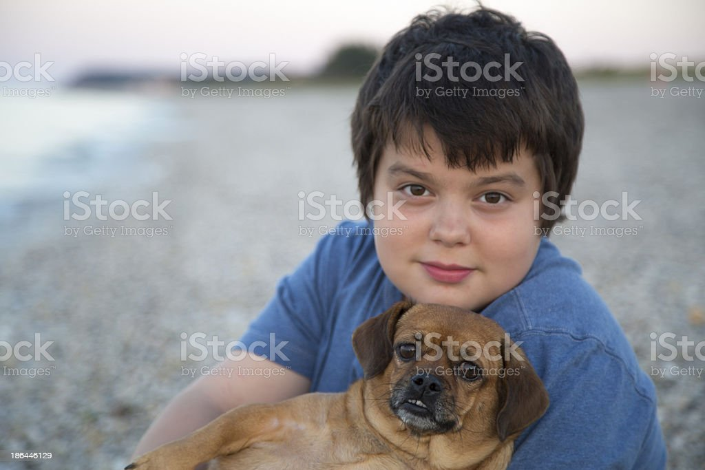 Cute boy with his dog royalty-free stock photo