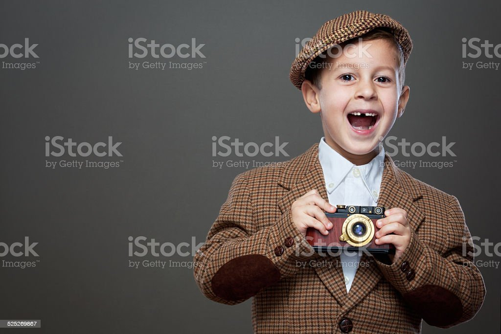 Cute boy with old photo camera. stock photo