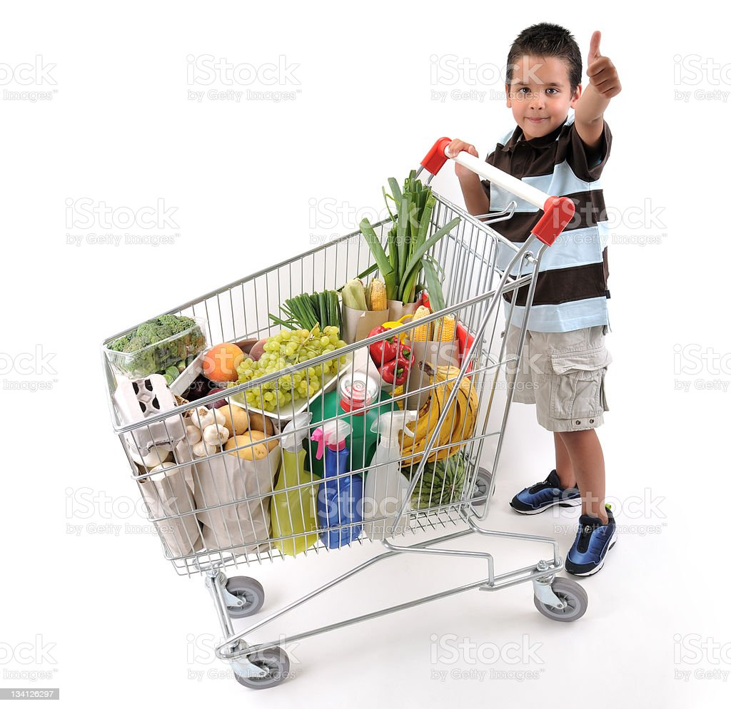 Cute boy with shopping cart royalty-free stock photo