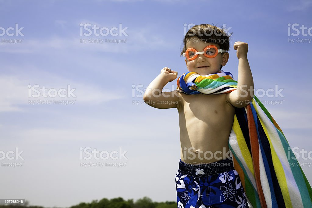 Cute Boy With Swimwear On Flexing Muscles royalty-free stock photo