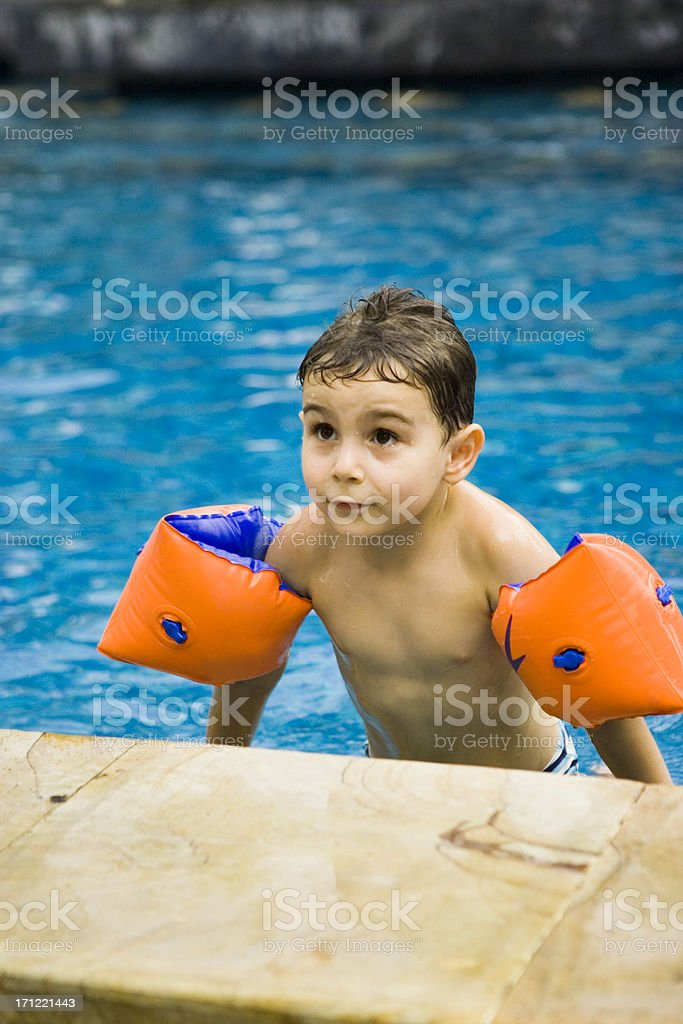 cute boy with water wings royalty-free stock photo