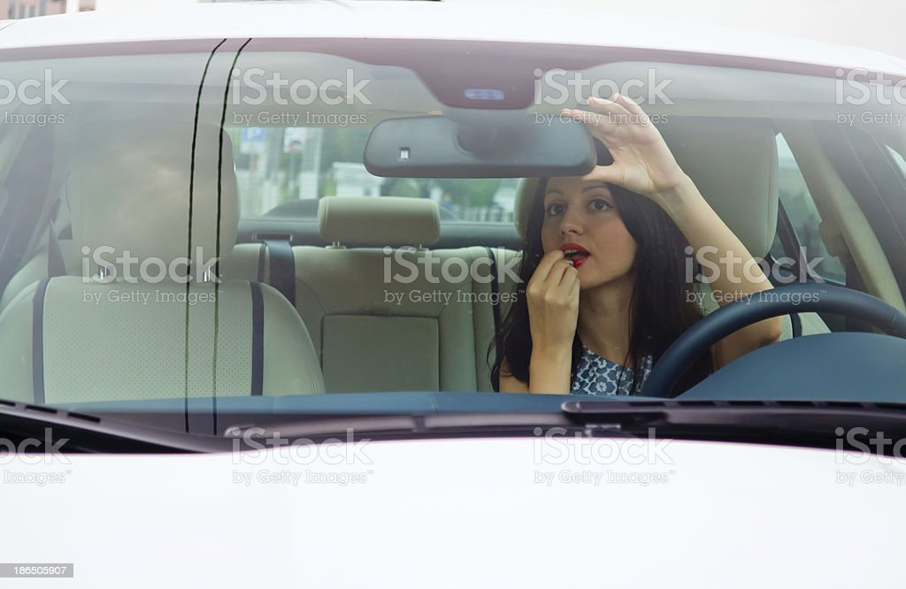 Cute brunette and luxury car royalty-free stock photo