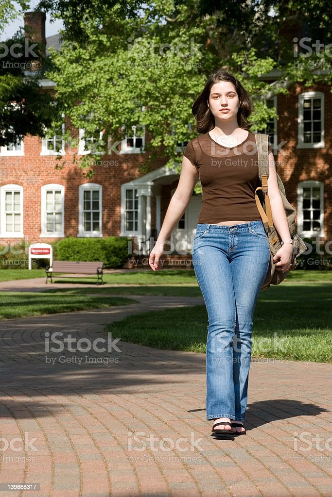 Cute brunette college student walking royalty-free stock photo