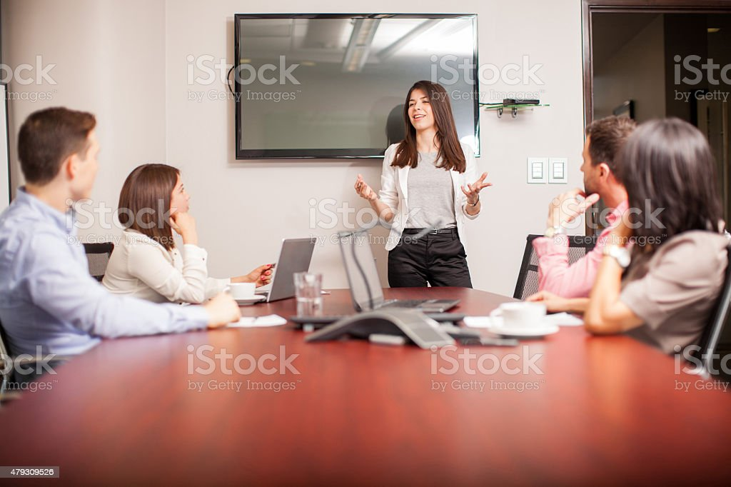 Cute brunette giving a presentation stock photo