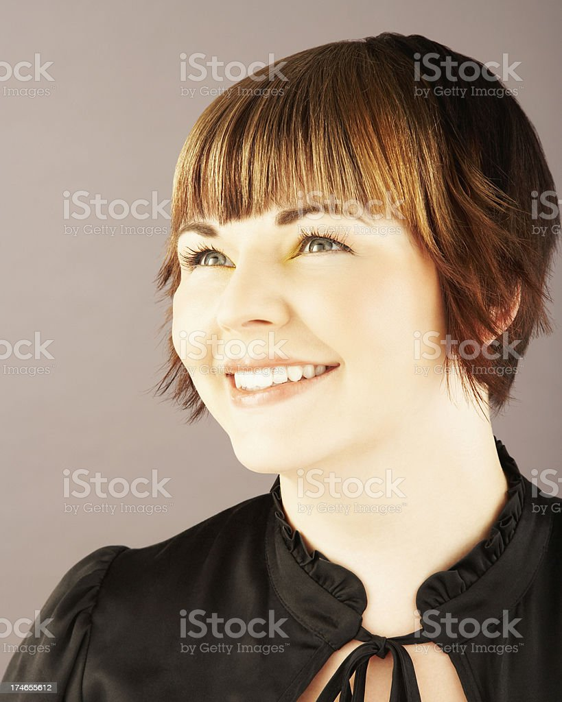 Cute Brunette Looking to the Side and Smiling royalty-free stock photo