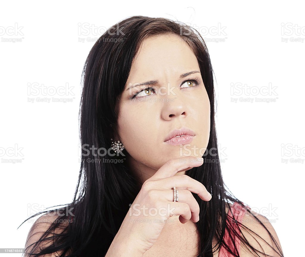 Cute brunette looks up, frowning in concentration royalty-free stock photo