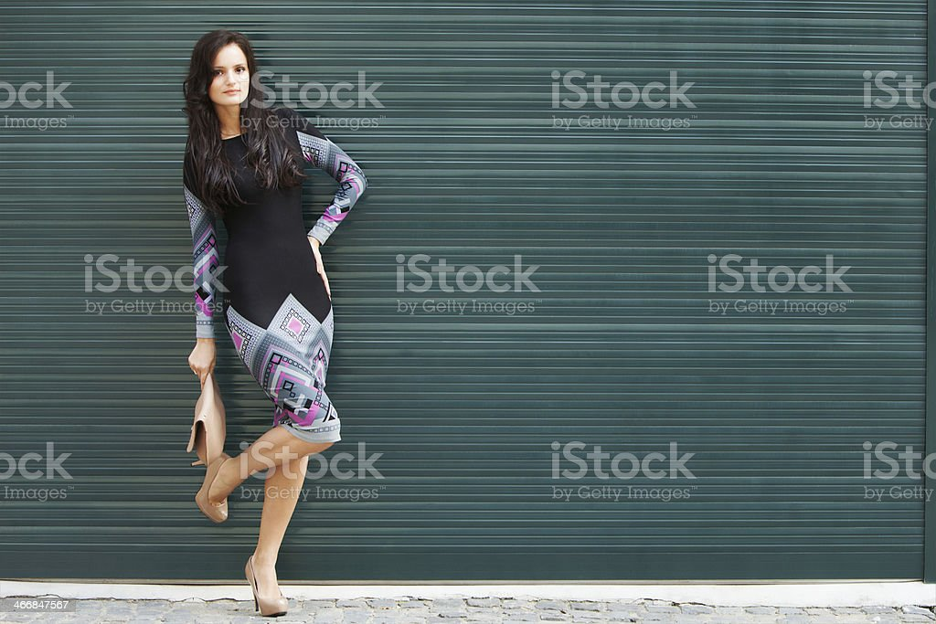 Cute brunette on a green wall royalty-free stock photo