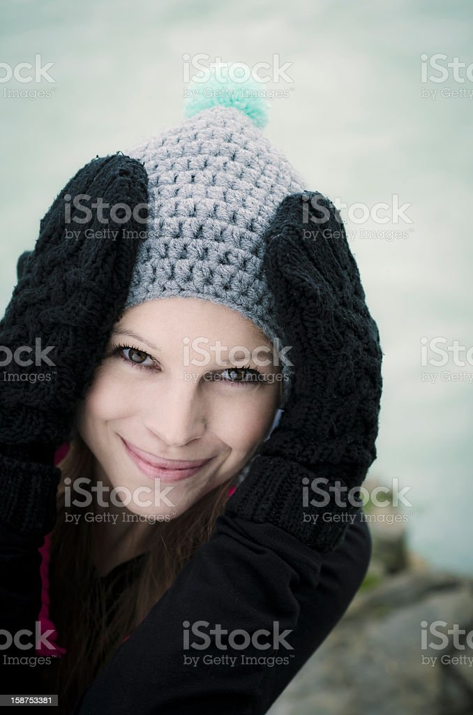 Cute Brunette with Woolen Cap an Gloves royalty-free stock photo