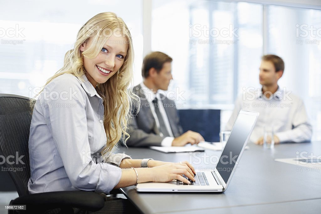 Cute business woman and colleagues in the conference room royalty-free stock photo