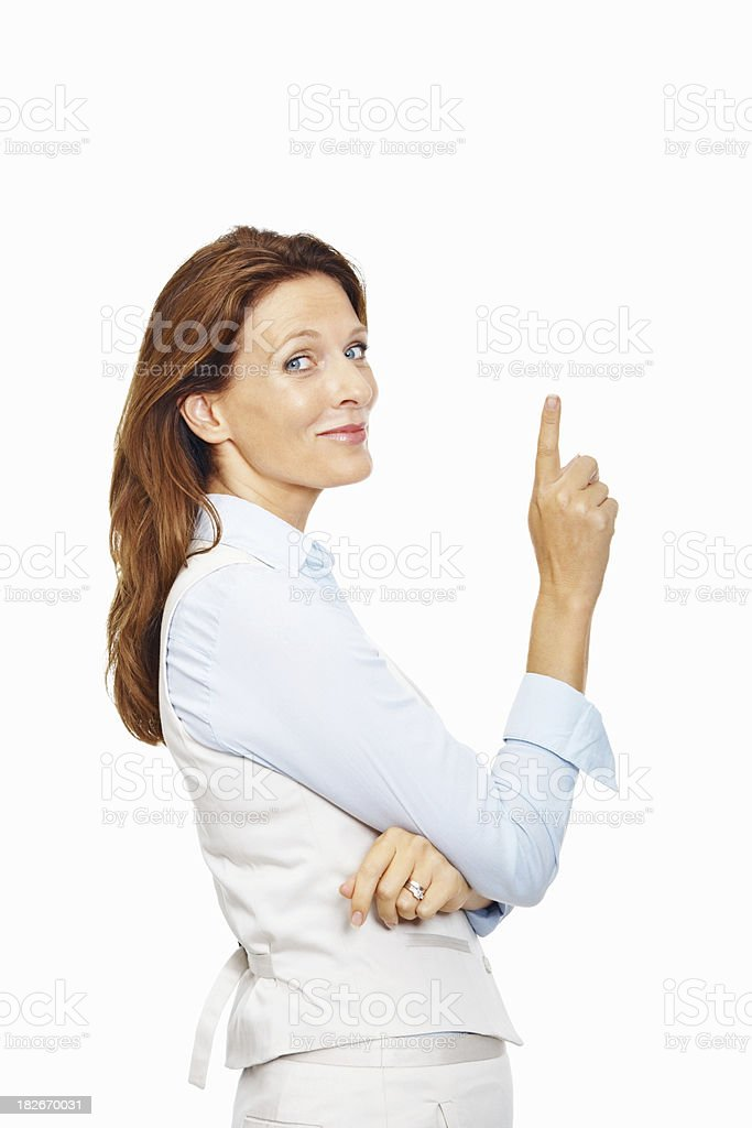 Cute business woman pointing at copyspace on white royalty-free stock photo