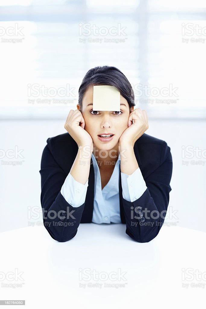 Cute business woman with an adhesive note on forehead royalty-free stock photo