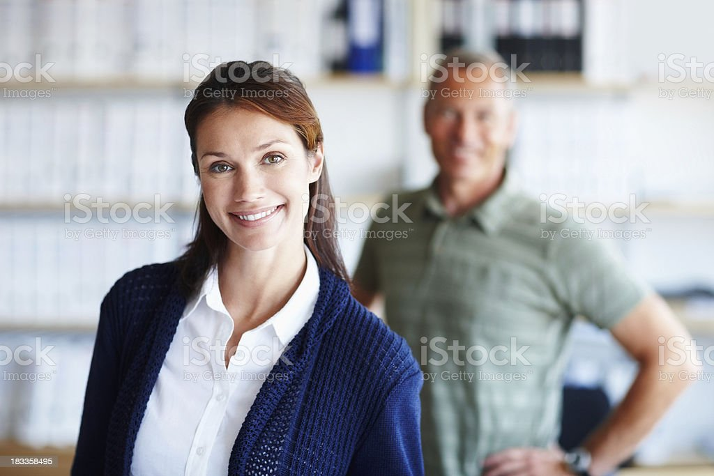 Cute business woman with male colleagues in the background royalty-free stock photo