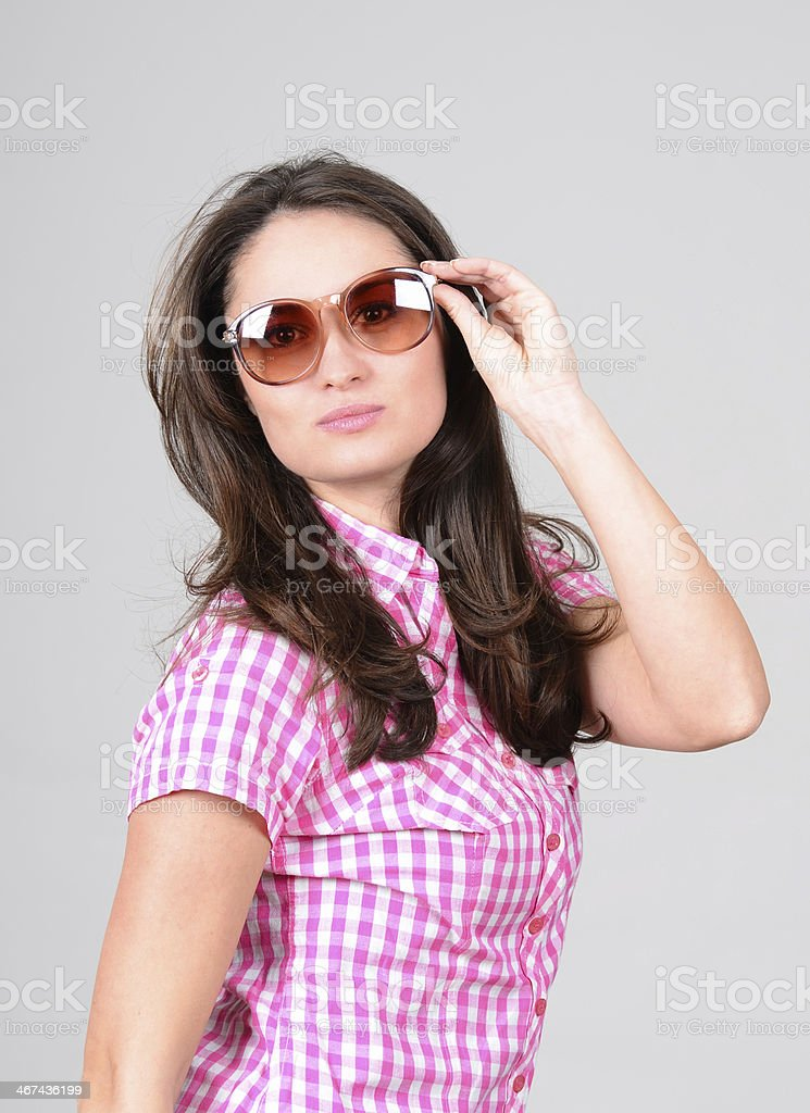 Cute caucasian young woman in casual fashion with sunglasses posing royalty-free stock photo
