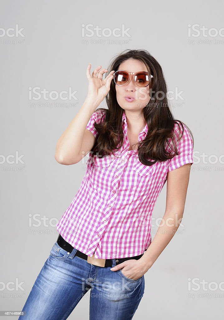 Cute caucasian young woman in plaid shirt with sunglasses posing royalty-free stock photo