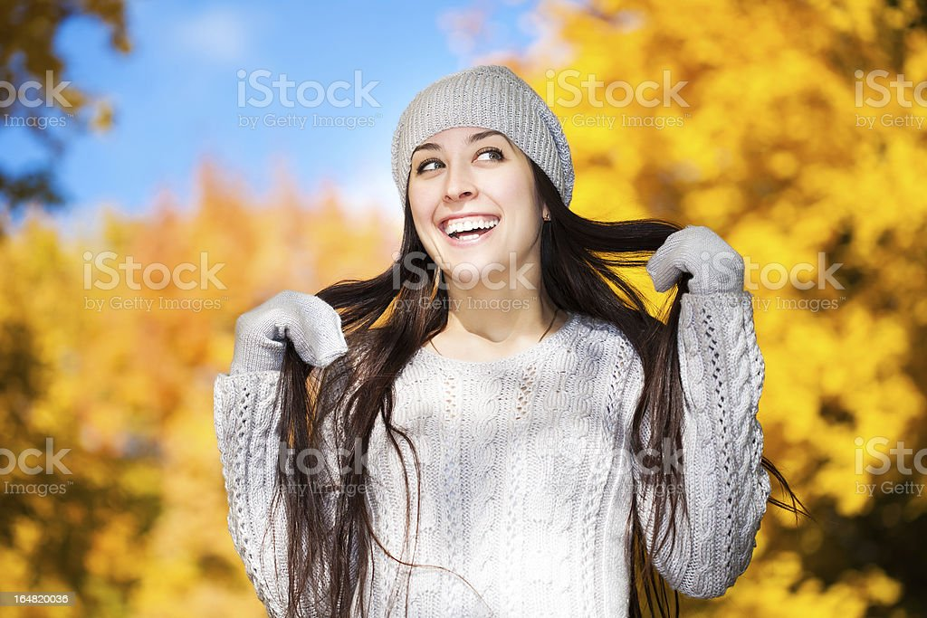 cute cheerful girl on a background of autumn trees royalty-free stock photo