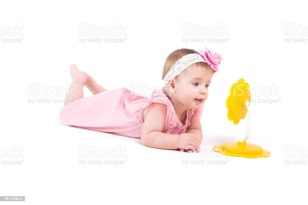 cute cheerful little girl in dress with mirrir stock photo