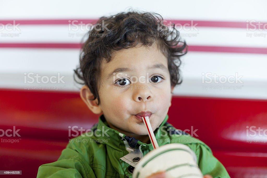 Cute Child Drinking a Milkshake royalty-free stock photo