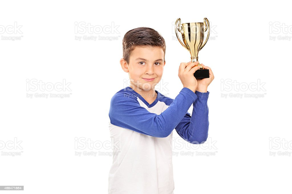 Cute child holding a golden trophy stock photo
