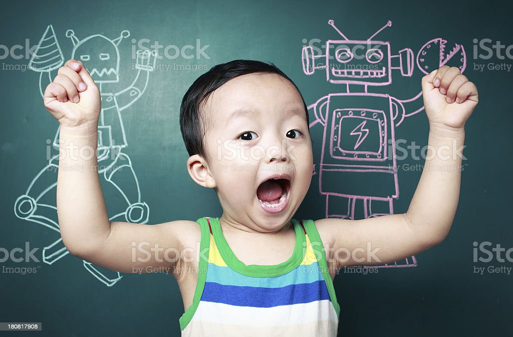 Cute child in front of the blackboard stock photo