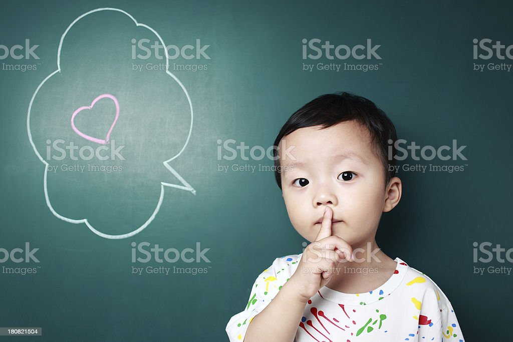 Cute child in front of the blackboard royalty-free stock photo