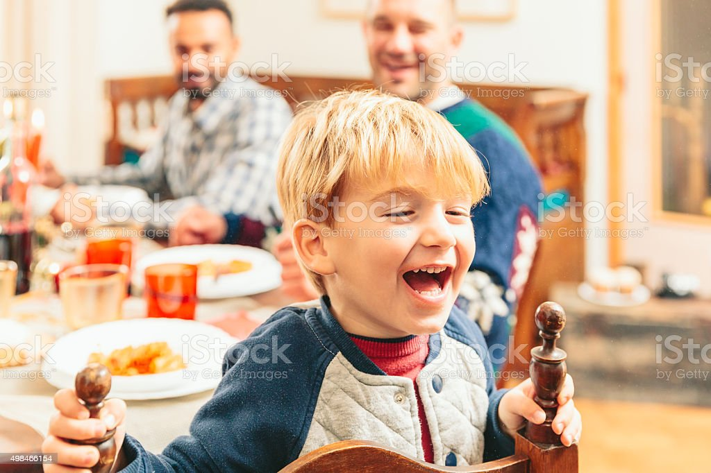 Cute Child making faces during the christmas dinner stock photo