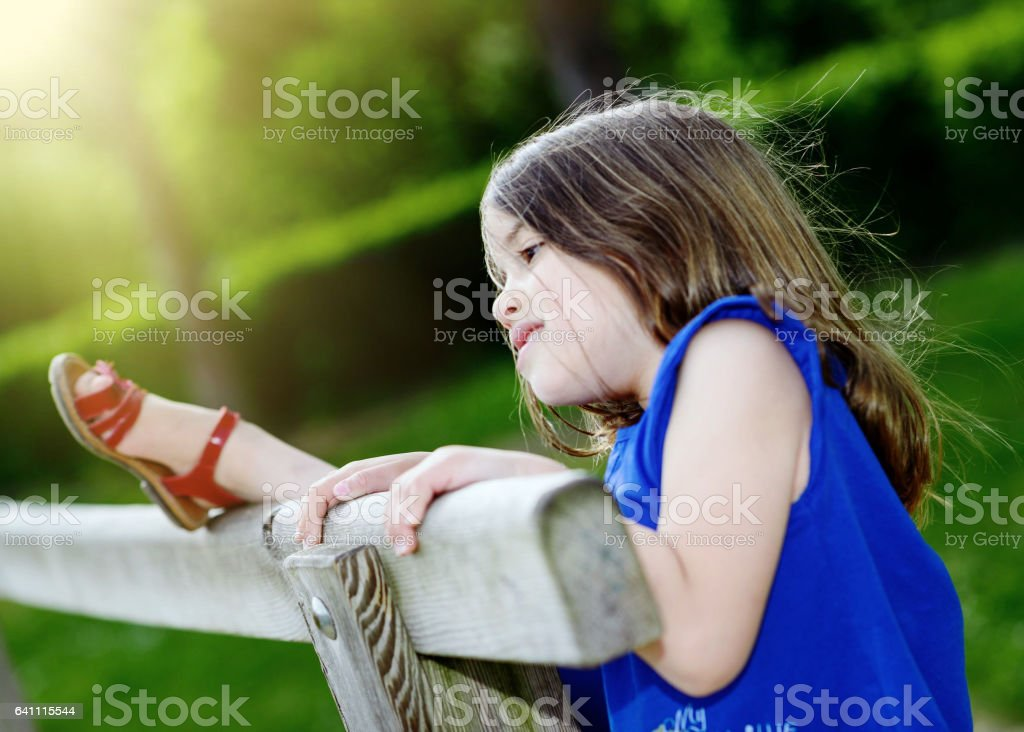 cute child playing with greenery in the background stock photo