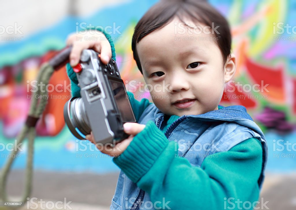 cute child plays the photographer royalty-free stock photo
