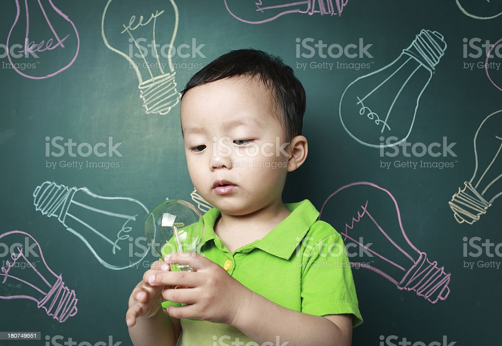 Cute child with a light bulb royalty-free stock photo