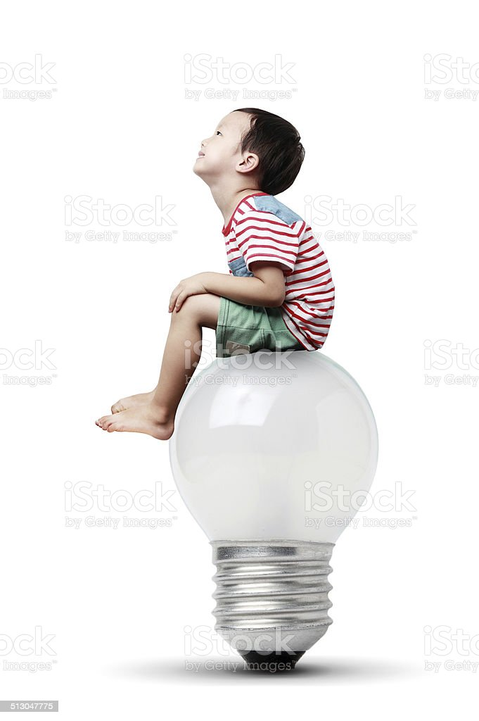 Cute child with a light bulb stock photo