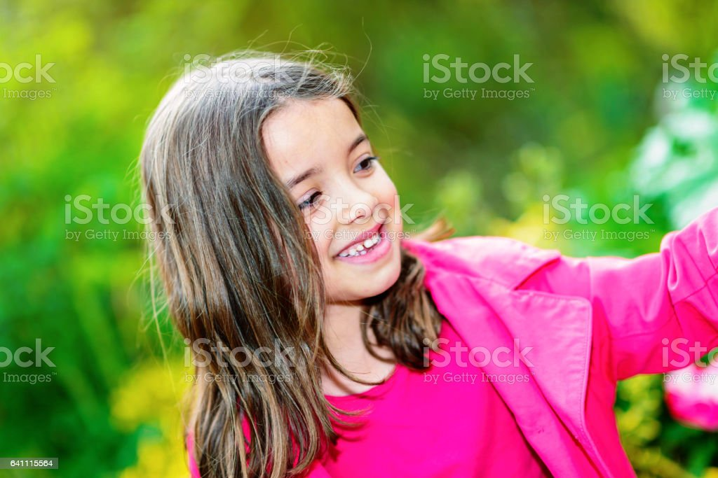 cute child with flower garden on background stock photo