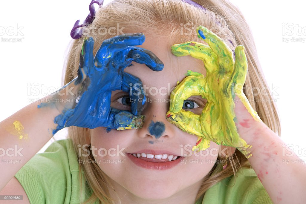 Cute Child with painted hands stock photo