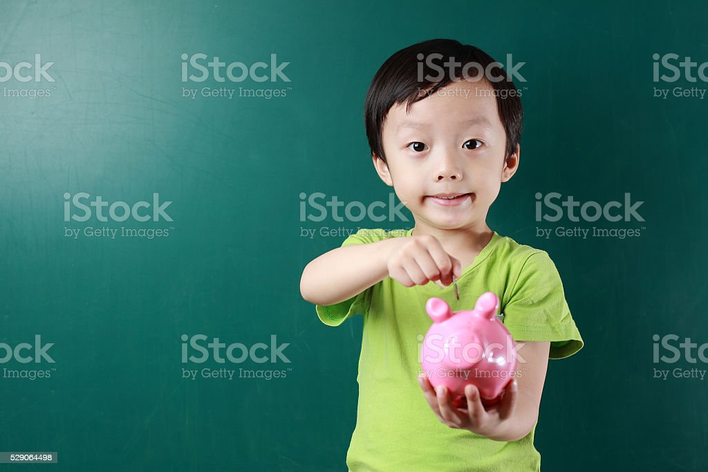 Cute child with piggy bank stock photo