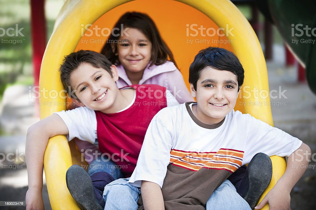 Cute children in the playground royalty-free stock photo