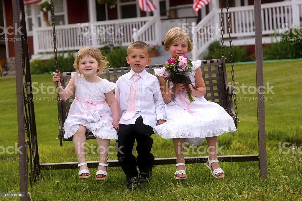 Cute Children on a Swing royalty-free stock photo