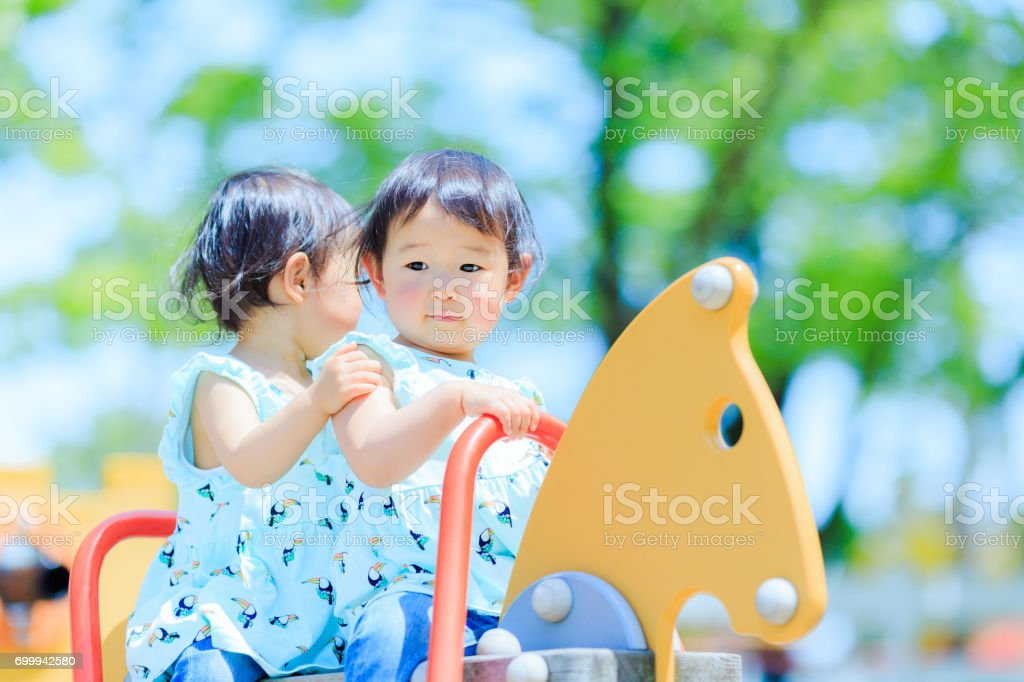 Cute children playing in the playground stock photo