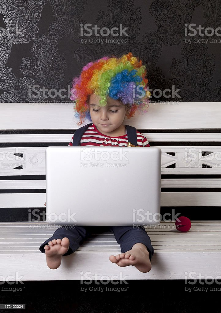cute clown with computer stock photo