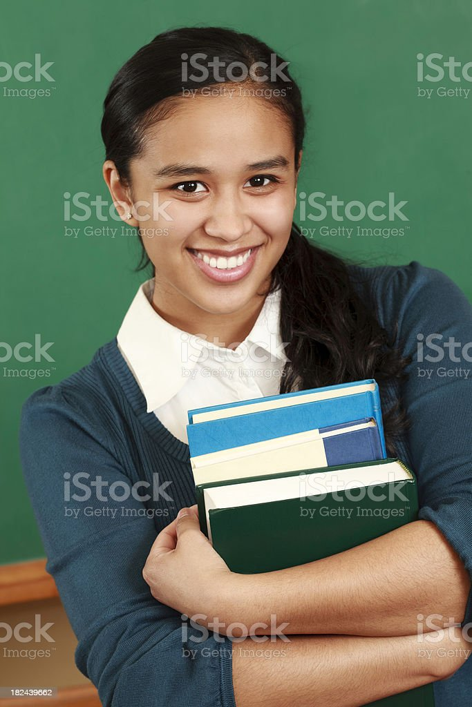 Cute College Student in front of School Chalkboard royalty-free stock photo