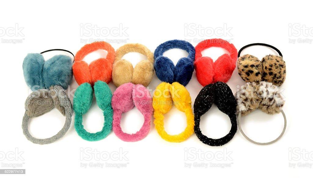 Cute colorful earmuffs arranged in a line. stock photo
