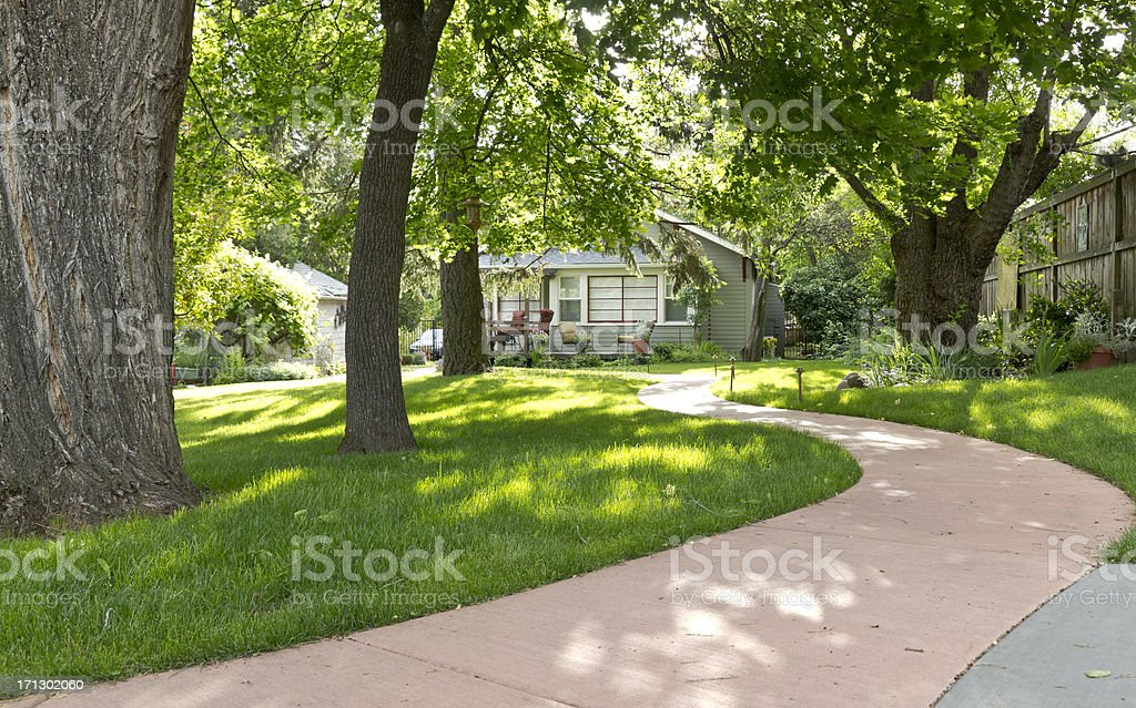 Cute Cottage at End of Winding Pathway stock photo