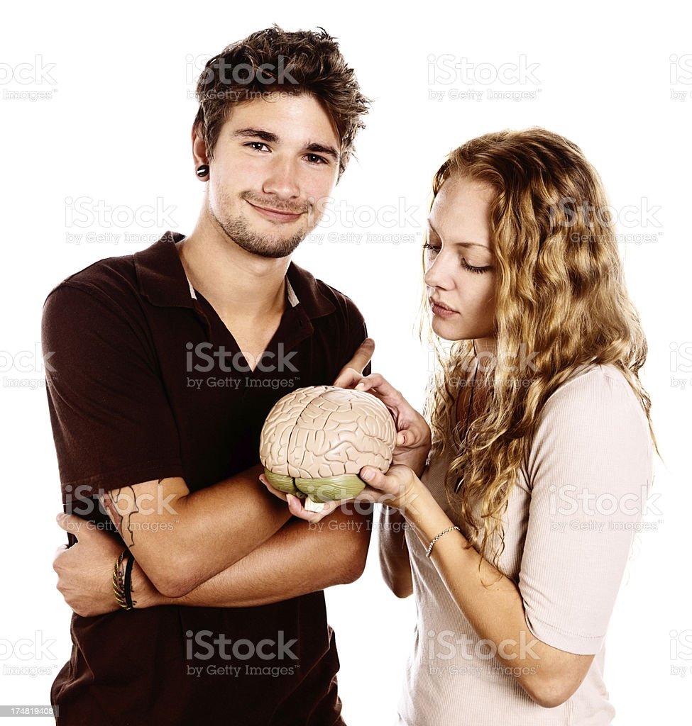 Cute couple are fascinated by scientific brain model stock photo