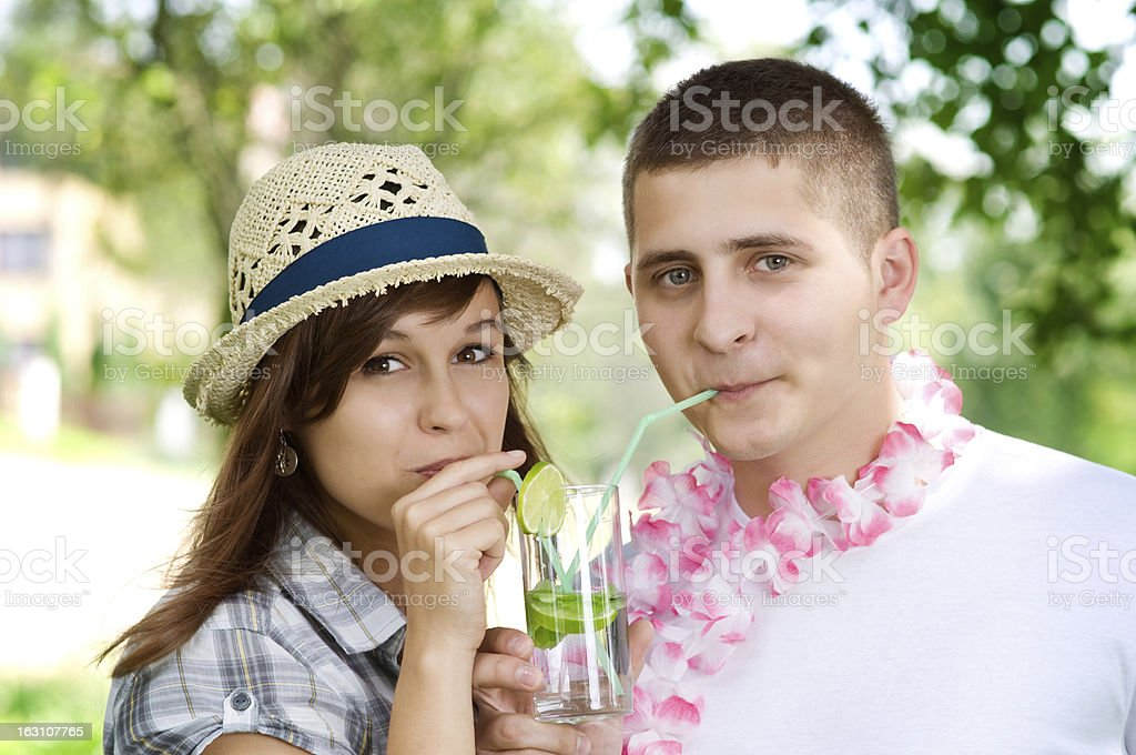 Cute couple drinking mojito coctail royalty-free stock photo
