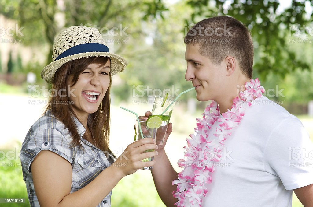 Cute couple drinking mojito coctail stock photo